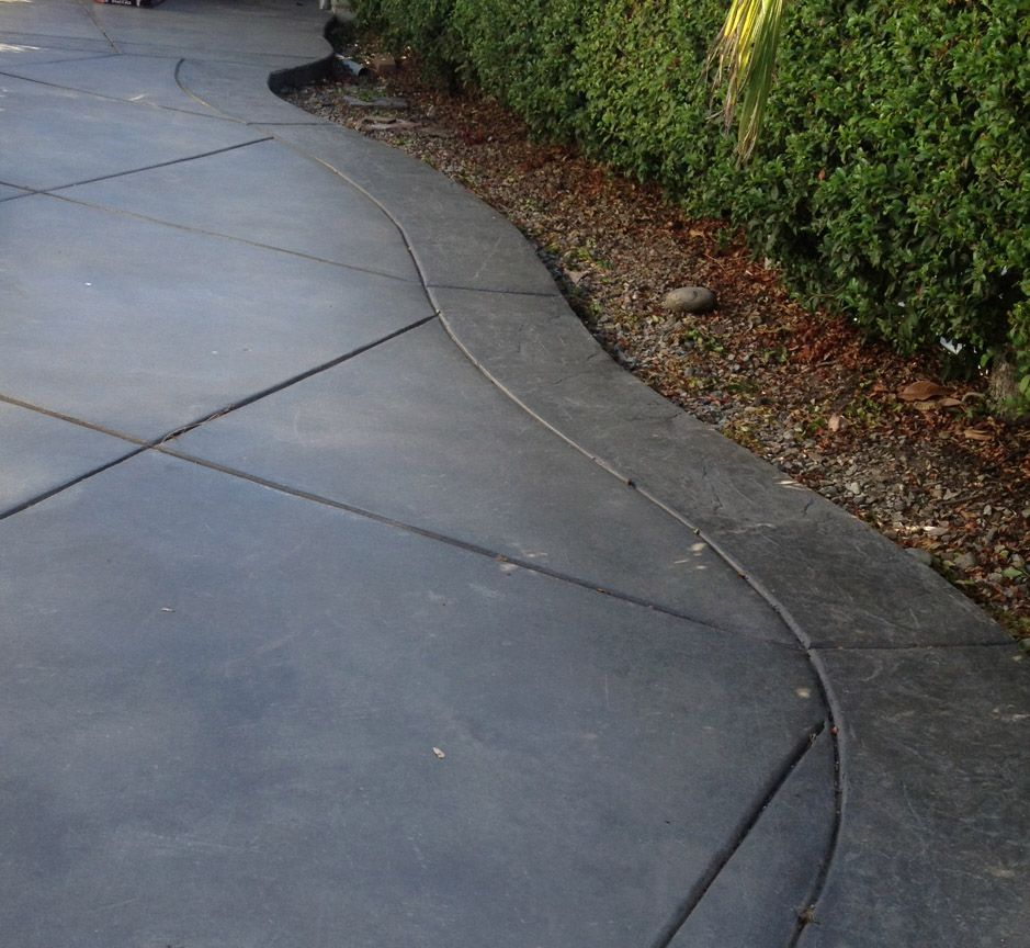 Additional Detail Of Neighbor's Stamped Concrete Driveway