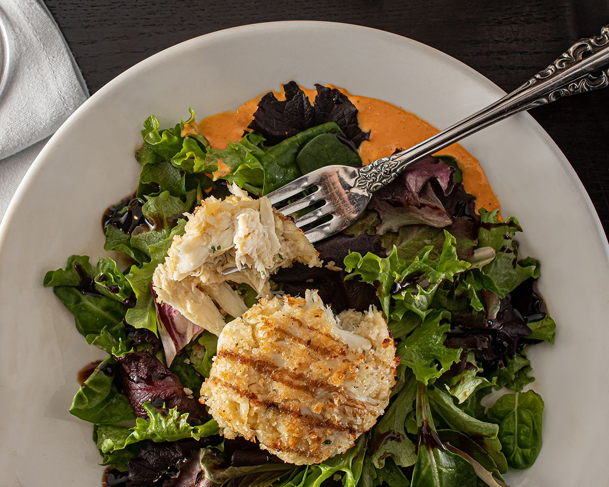 Crab cake with fresh greens food clean eating