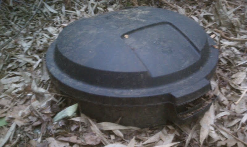 Make Your Own Dog Poop Composter Beside The Front Of The