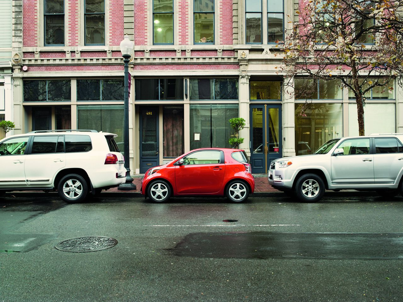 The 2013 Scion iQ allows you to park in the tiniest of