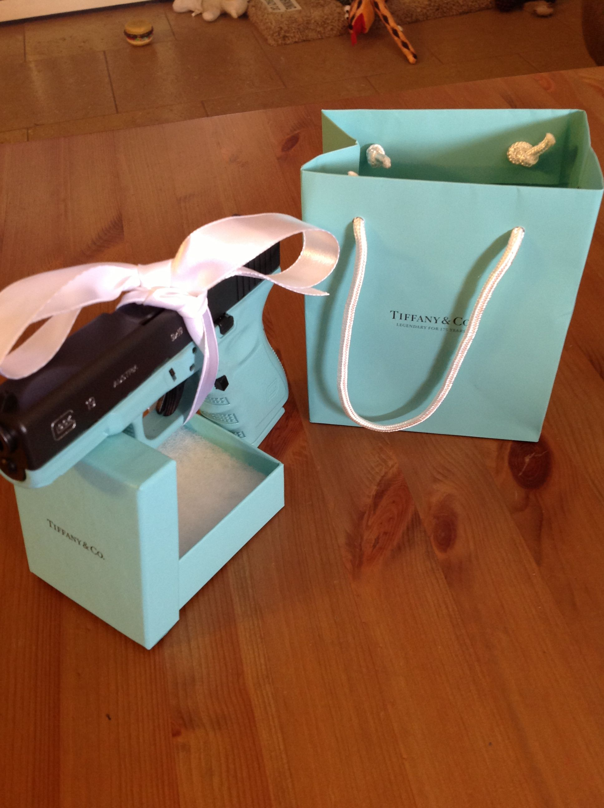 Glock 9mmif my husband gave me a tiffany bag and this is what I