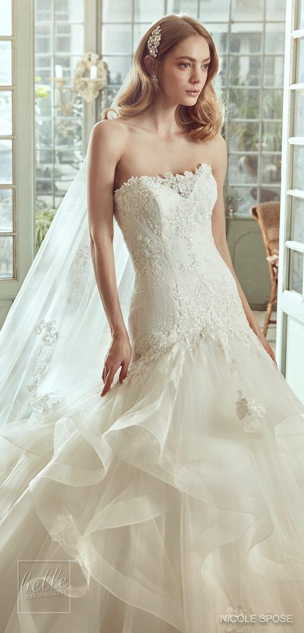 Wedding dresses with ruffles on skirt  Nicole Spose Wedding Dress Collection   Fitted lace bridal gown
