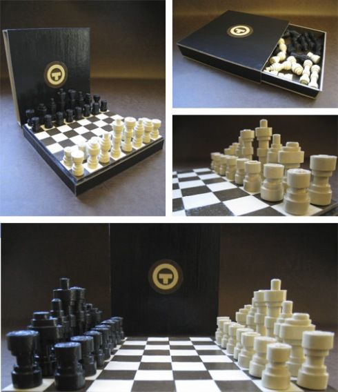 Holy cr*p, an entire paper chess set! Men are made from black and cream colored rolled paper.