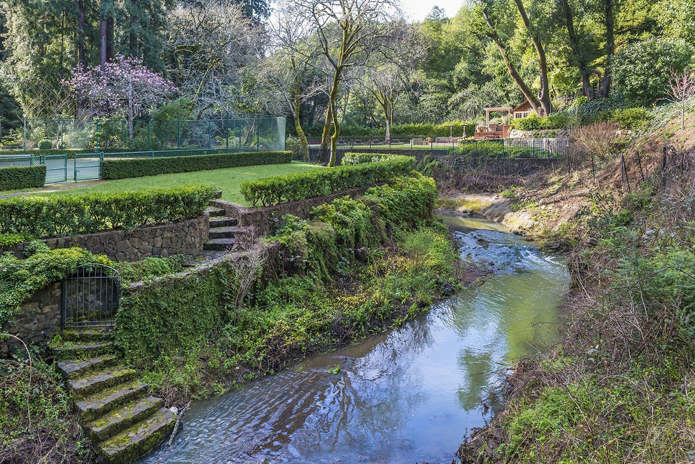 An Amazing Backyard Is Hiding Behind This California Estate is part of Luxury garden, Large backyard landscaping, Backyard, Backyard landscape architecture, Backyard landscaping, Large backyard - A treehouse and suspension bridge are just the beginning