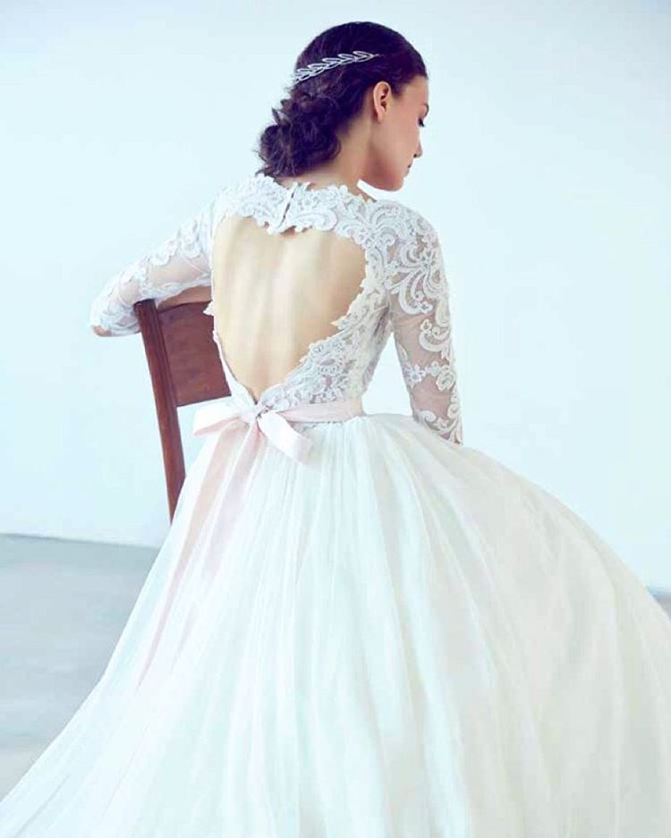 The heart-shaped cut-out on this gown from Bluebay Wedding