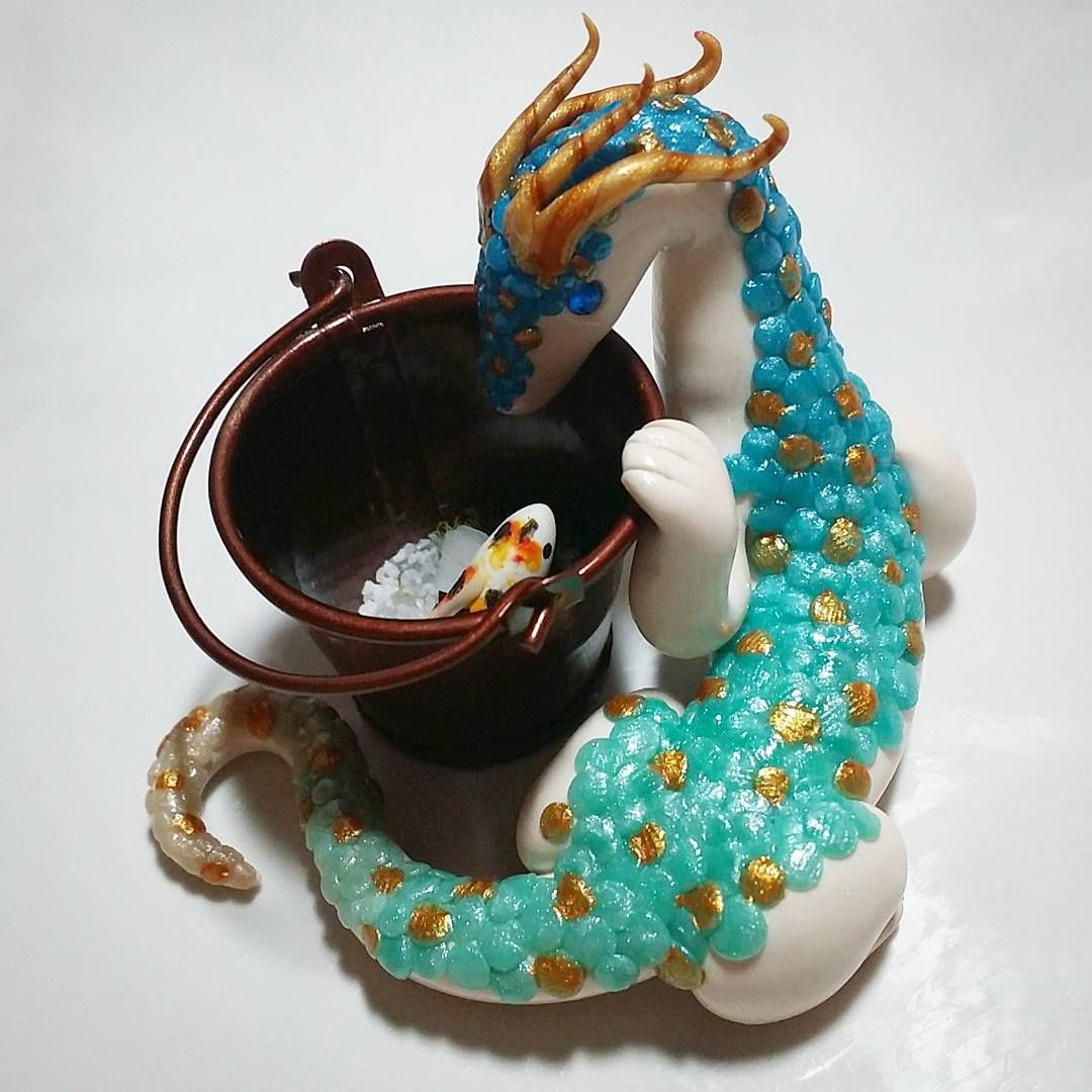 The Instagram giveaway item is nearly ready! Just need to add in the resin tomorrow, and once it's dry, I'll post the actual giveaway. :) #handmade #polymerclay #miniatures #dragons #dragon #miniaturepond #koi #koipond #fish #giveaway #wip