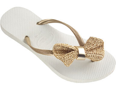 These adorable sandals are the perfect touch of feminine style. The sweet bow on the strap, made from buriti, which is extracted from the moriche palm tree, is truly an original piece of art. Handsewn by local artisans in Brazil.Online Exclusive Style. Limited Edition. Limited Quantities.