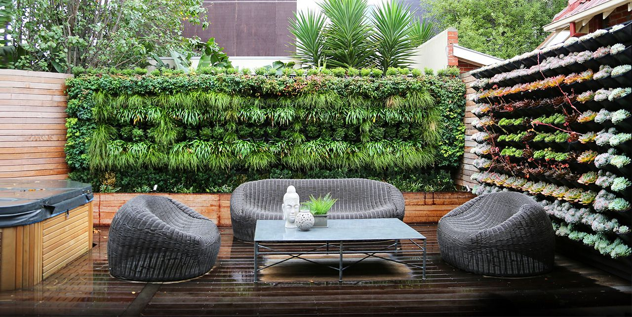 frame a patio space with a beautiful hanging garden wall garden