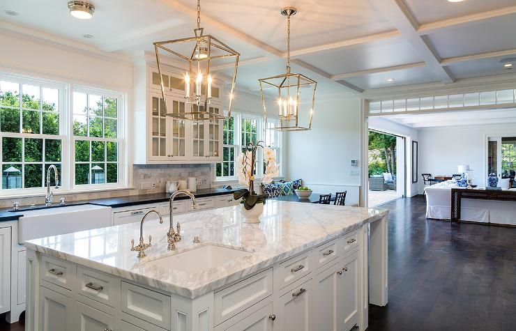 A Pair Of Darlana Lanterns Hang Over A White Kitchen