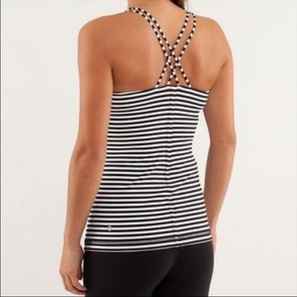 Lululemon black and white striped tank 8 The size tag is cut off but size button inside confirms that it's a size 8. No holes or rips. In great condition. So cute! lululemon athletica Tops