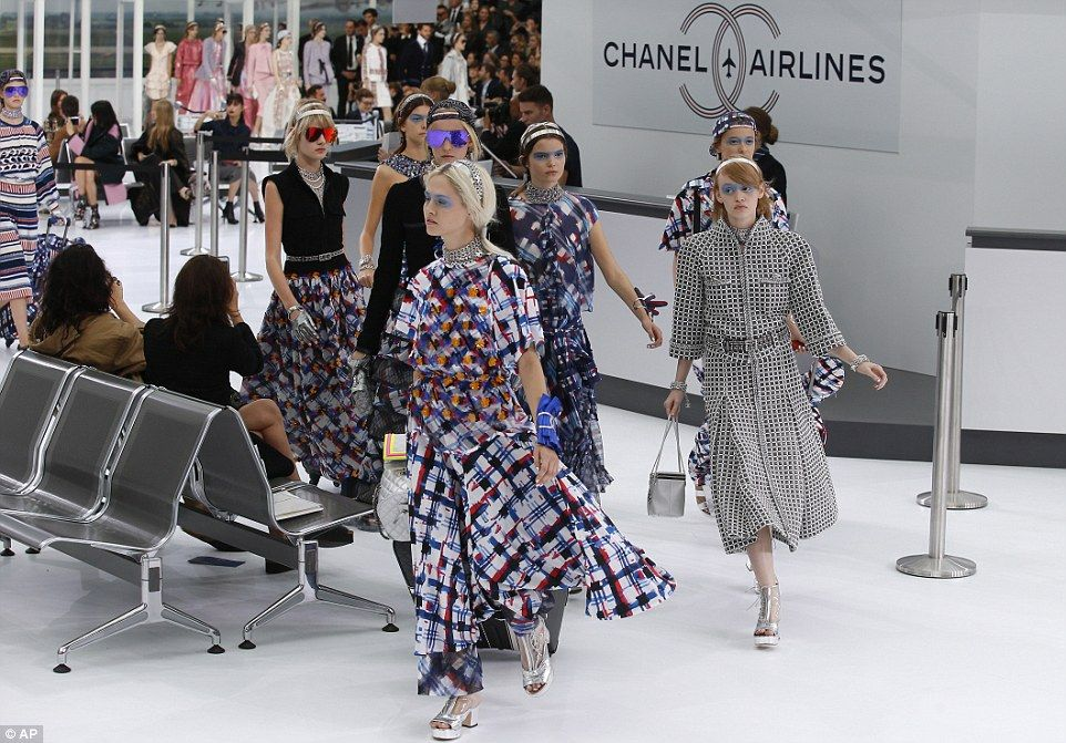 Ladylike twist: Models wore headbands and demure bags in keeping with fashion house founde...