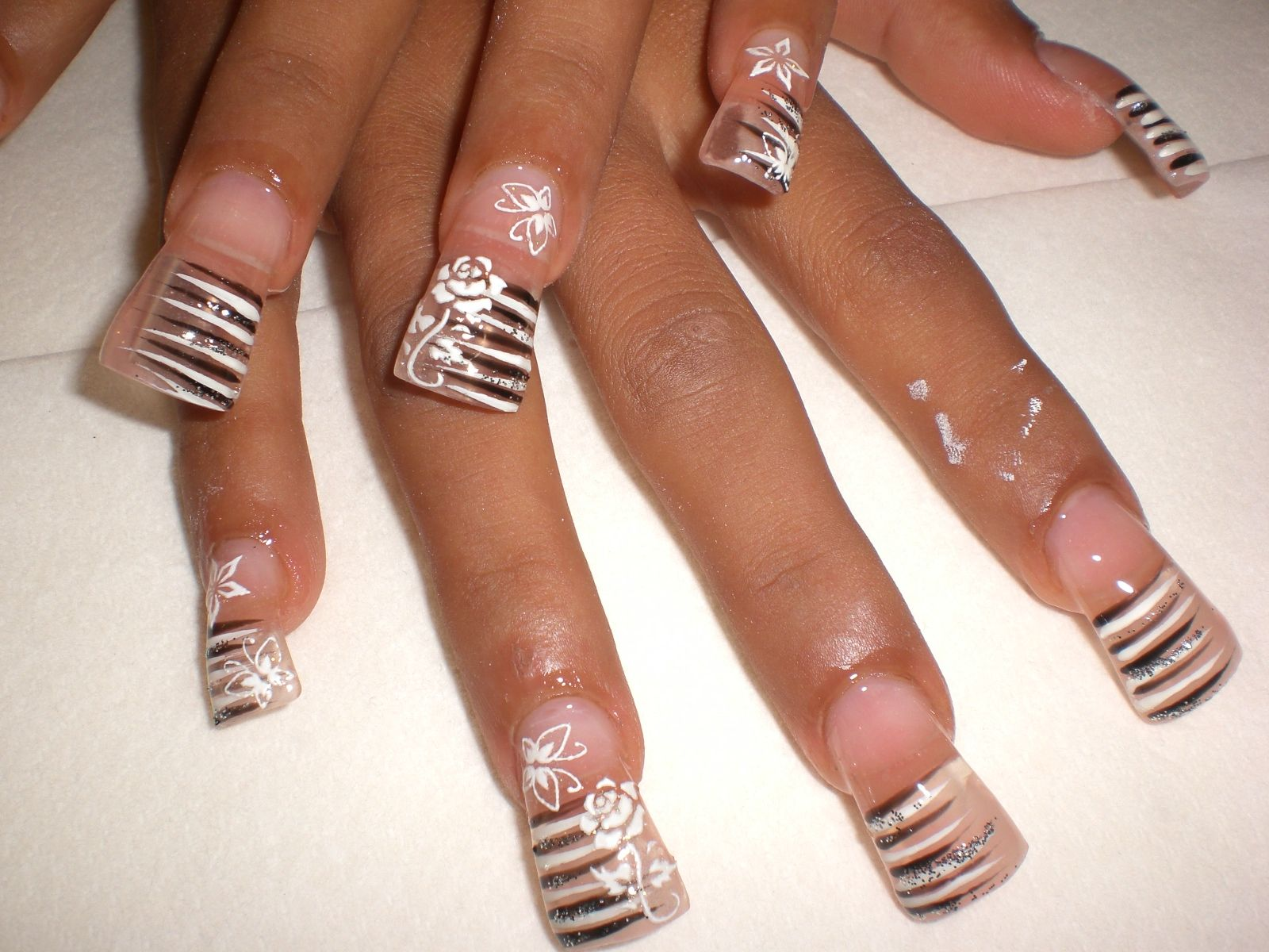 long nails with white flowers