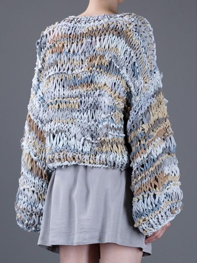Grey stretch cotton sweater from Steinwidder featuring a round neck, a wide knitted design, raw edges and long kimono sleeves.