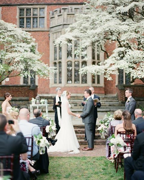 There's no better place for a spring wedding than under flowering dogwood trees. So romantic! photo: @martalocklearphoto #snippetandink #meaningfulwedding