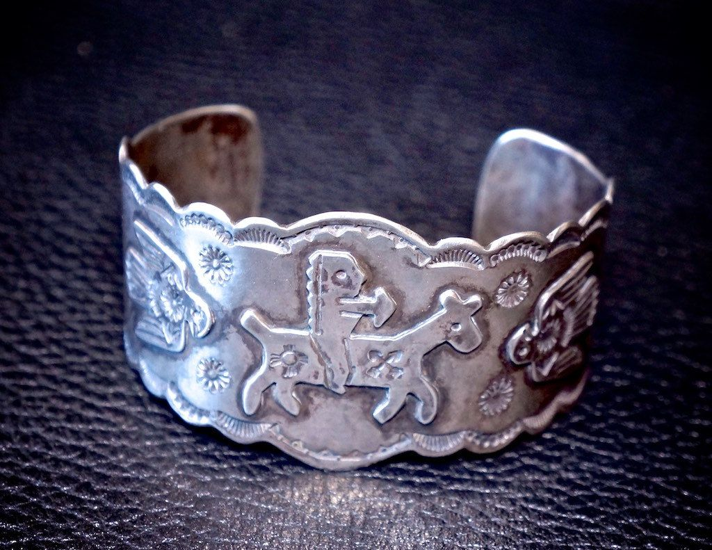 "Fred Harvey Vintage Unusual Silver Indian on Horseback.Rare Fred Harvey 1920s bracelet of an Indian on horse back with Thunder Birds and Crossed Arrows ! Measures 6 3/4"" around including the gap. Measures 1 1/2"" at tallest point. Weight 49.2 grams  by FarRiderWest on Etsy SOLD"