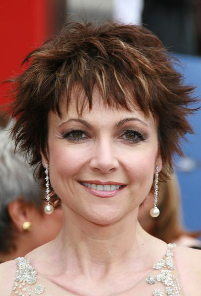 Short hairstyles for women over 50 with glasses Short