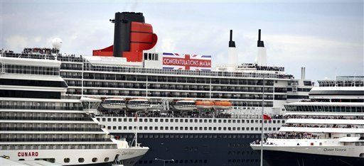 Photo made available by Cunard Lines shows their ships Queen Victoria, Queen Mary2, and the Queen Elizabeth on June 5, 2012, after sailing into Southhampton together for the first time.