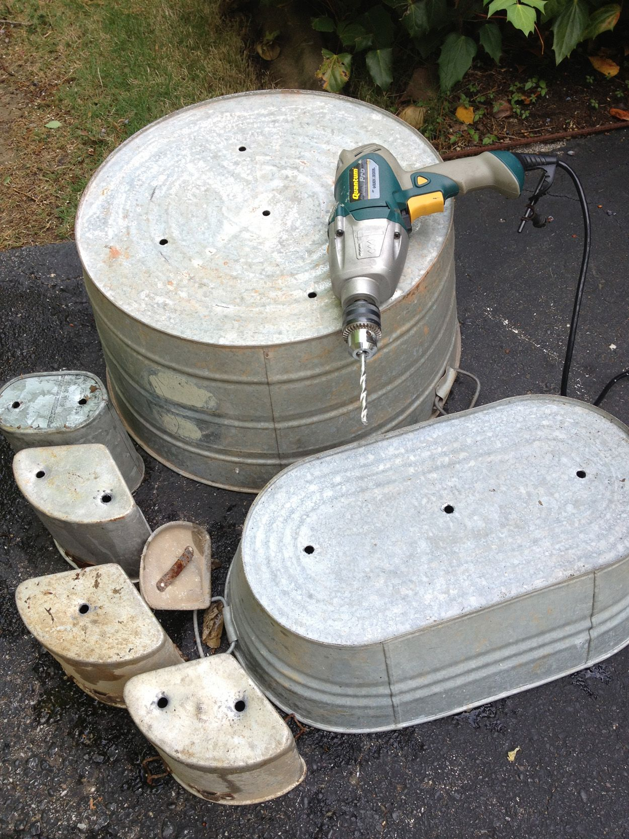 Drill Holes In Galvanized Tubs To Turn Them Into