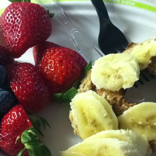 My power morning breakfast.  6 grain whole wheat bagel thin with almond butter( i use trader joes with flax seed) and bananas. With a side of berries. Love this !!!