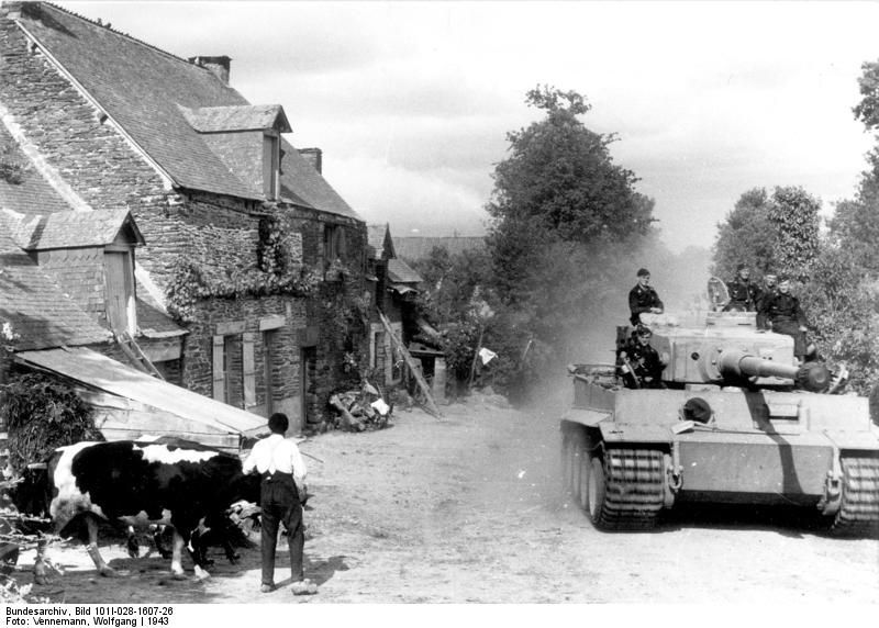Early model German PzKpfw VI Tiger I heavy tank in a village in France, 1943 (Photographer Wolfgang Vennemann, German Federal Archive)