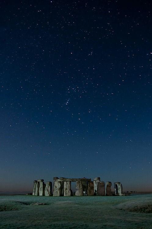 Stonehenge, prehistoric monument located in Wiltshire, England, UK - under starry night