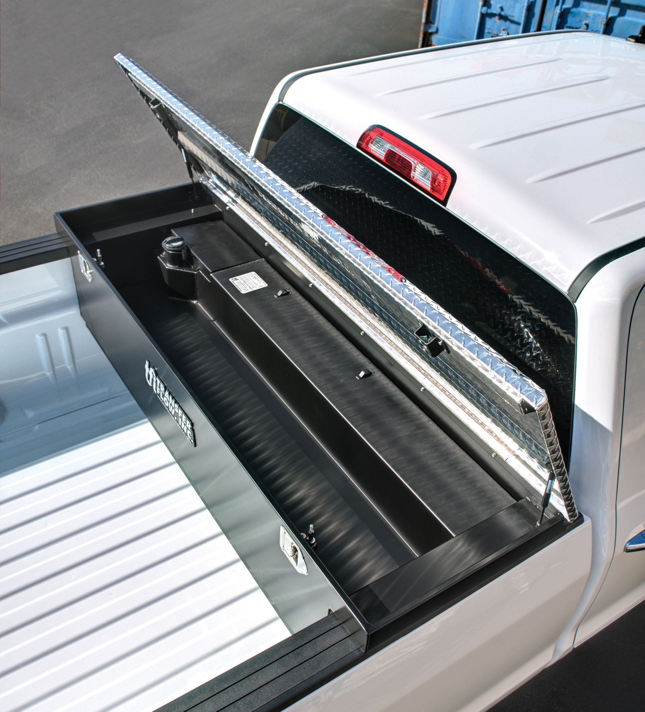 Transfer flow s new toolbox and fuel tank combo has an adjustable storage box to custom fit the depth of your truck bed