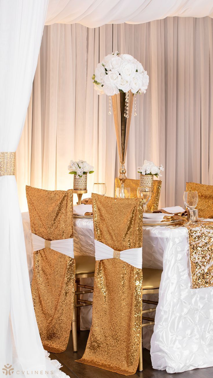 White wedding decor ideas  Romantic white and gold wedding set up with sequins  white wedding