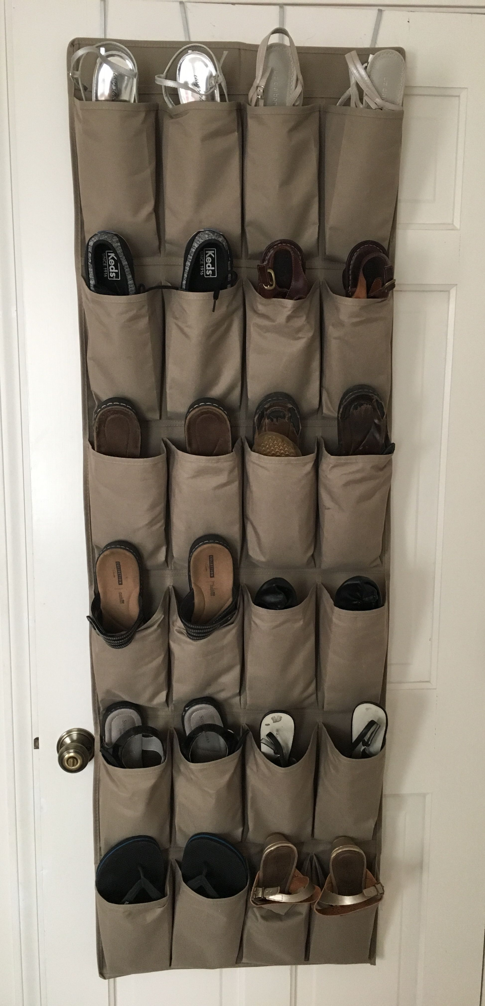 Organized shoes for all seasons #summerhomeorganization Creating a shoe holder with spring/summer shoes and a 2nd with fall/winter shoes makes changing seasons easier! #summerhomeorganization