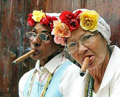 Older women in flower caps & cigars  These ladies are more my style!