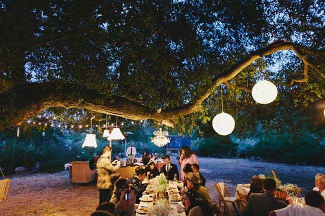 dinner outdoors under the stars + white globe lights for this Great Gatsby inspired wedding!
