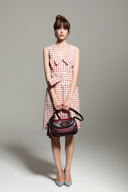 Stacey (Pricillas) wears Prada dress and shoes and Gucci bag.