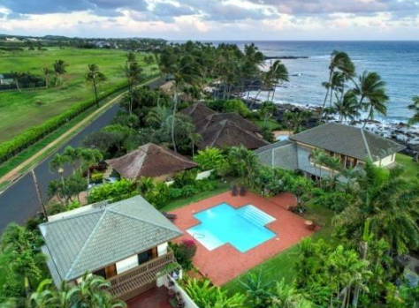 Large estate For Sale on Kauai. Oceanfront, guest house, tropical gardens, open floorpan, huge bedrooms, amazing pool, kayak storage, all within steps of the Pacific Ocean.