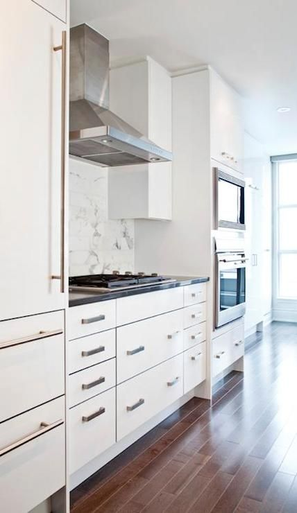 Sleek White Kitchen With White Flat Front Cabinets