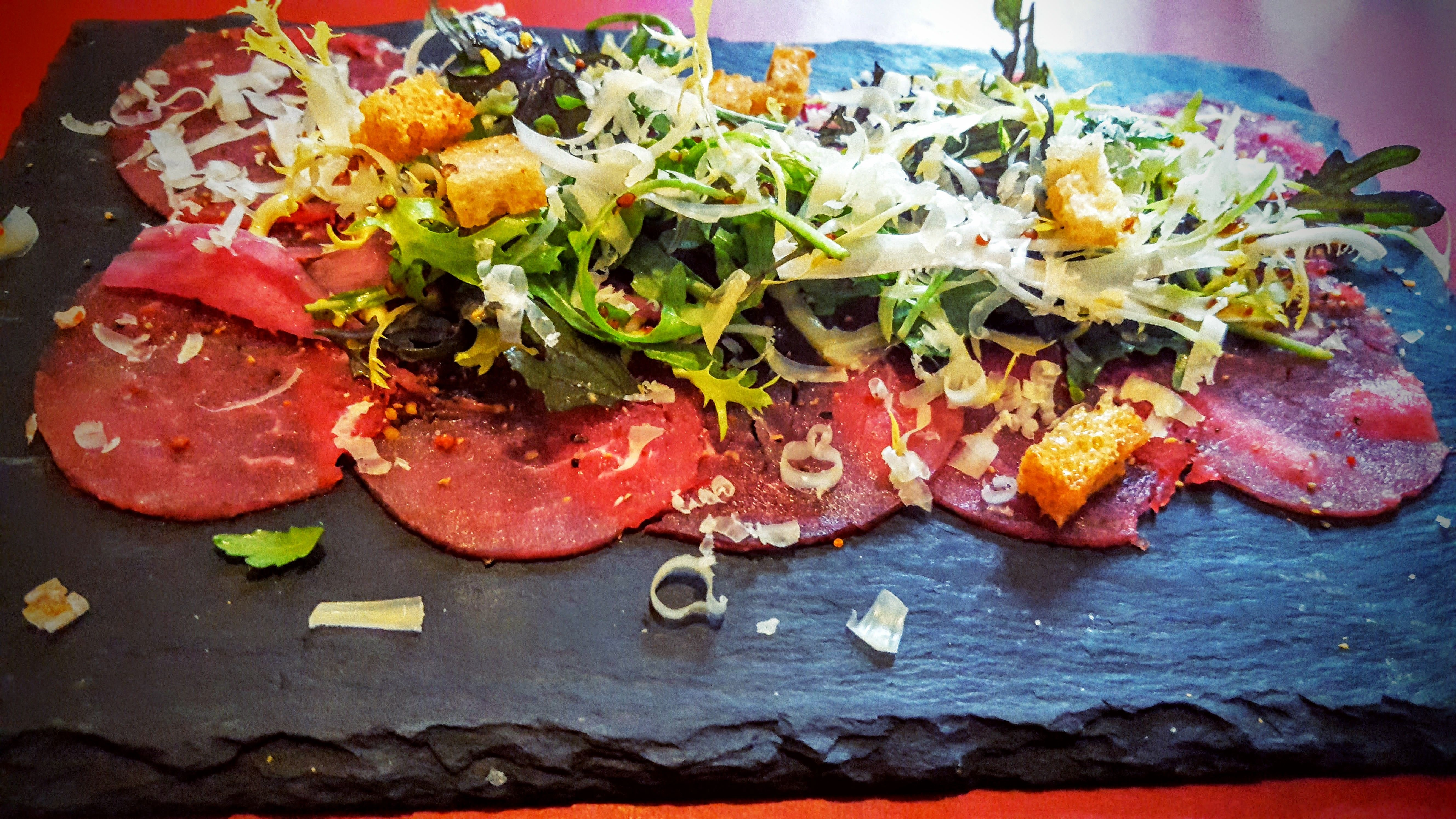 Köd Aarhus carpaccio of danish tenderloin with Vesterhavs cheese, rucola, pickled onions and cracked black pepper & crunchy croutons