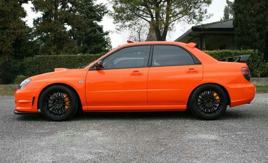 Orange Subaru With Black Wheels