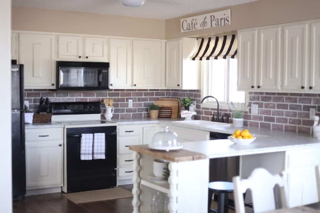 French Country Kitchen Faux Marble Countertops Brick Backsplash My Chic Obsession French Country Kitchen Country Kitchen French Country Kitchens