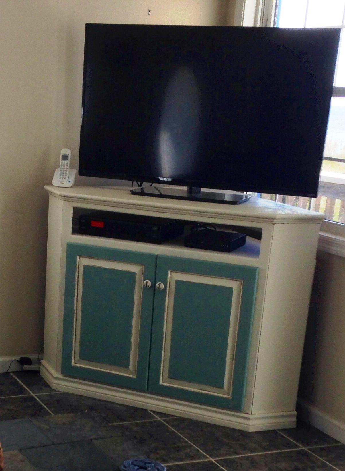 Corner tv stand refinished with chalk paint aged with dark wax