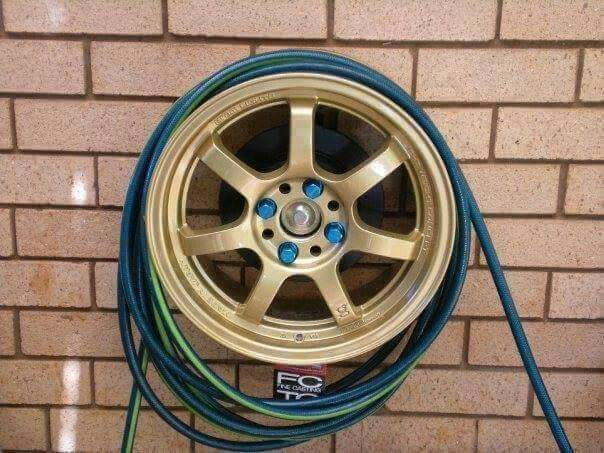 Repurposed Car Tire Rim Hose Holder Diy Car Projects Car Parts Decor Car Part Furniture