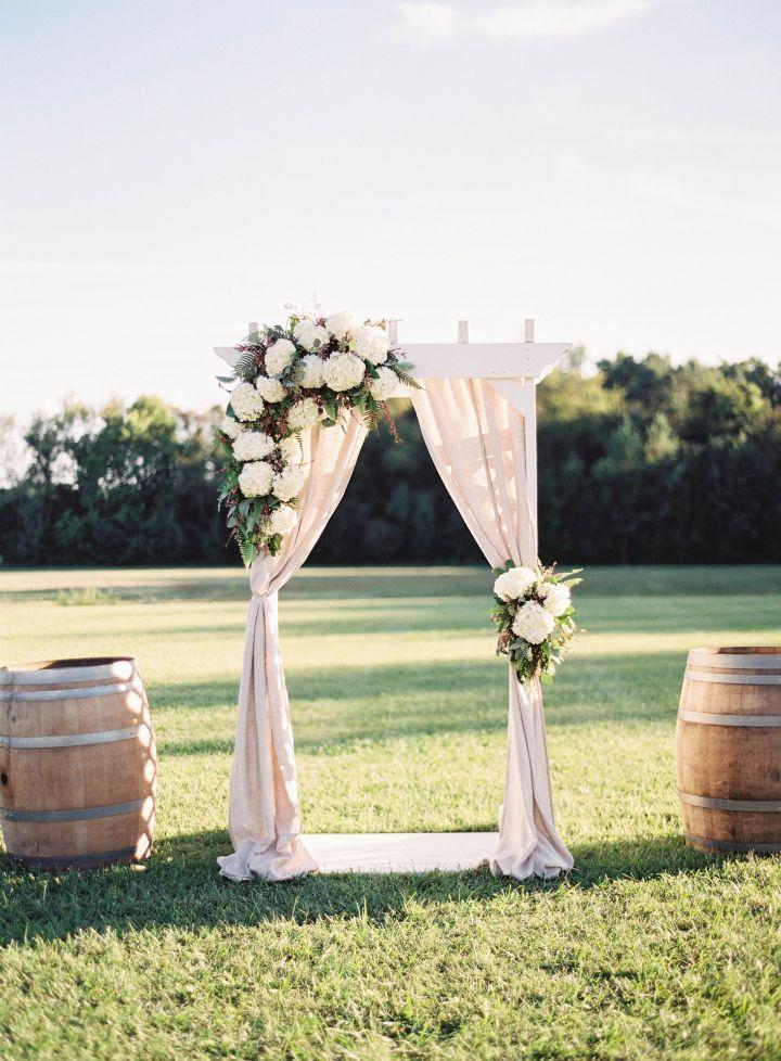 Beautiful simplicity wedding arch with fabric draping + greenery ...
