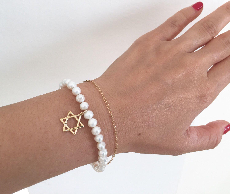 A personal favorite from my Etsy shop https://www.etsy.com/il-en/listing/469702142/star-of-david-beaded-bracelet-pearl