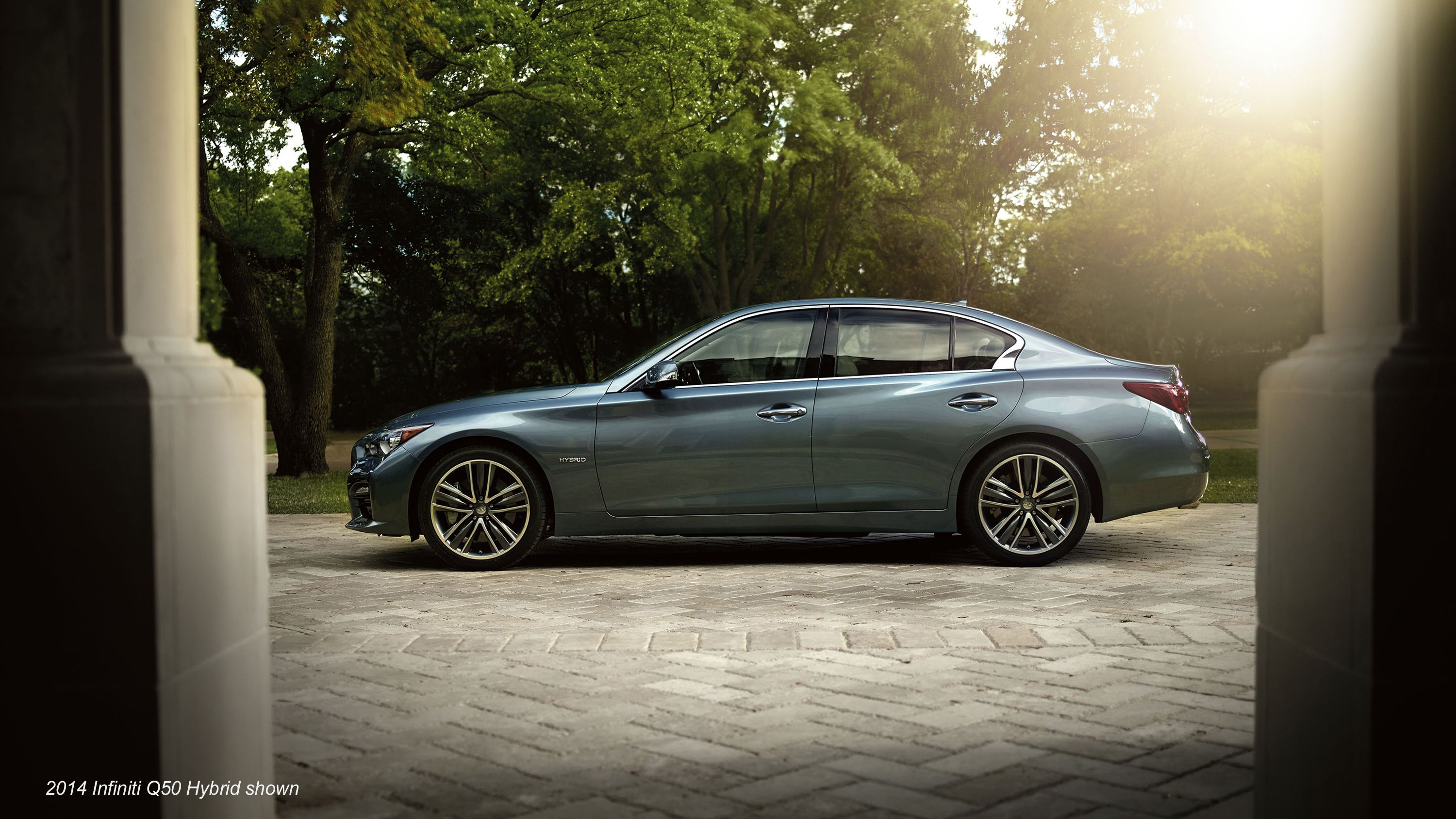 2015 infiniti q50 sedan exterior driver s side profile in graphite shadow highlighting 5 spoke