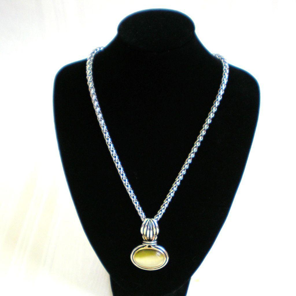 Silvertone and goldtone necklace with bezel set pendant pendants
