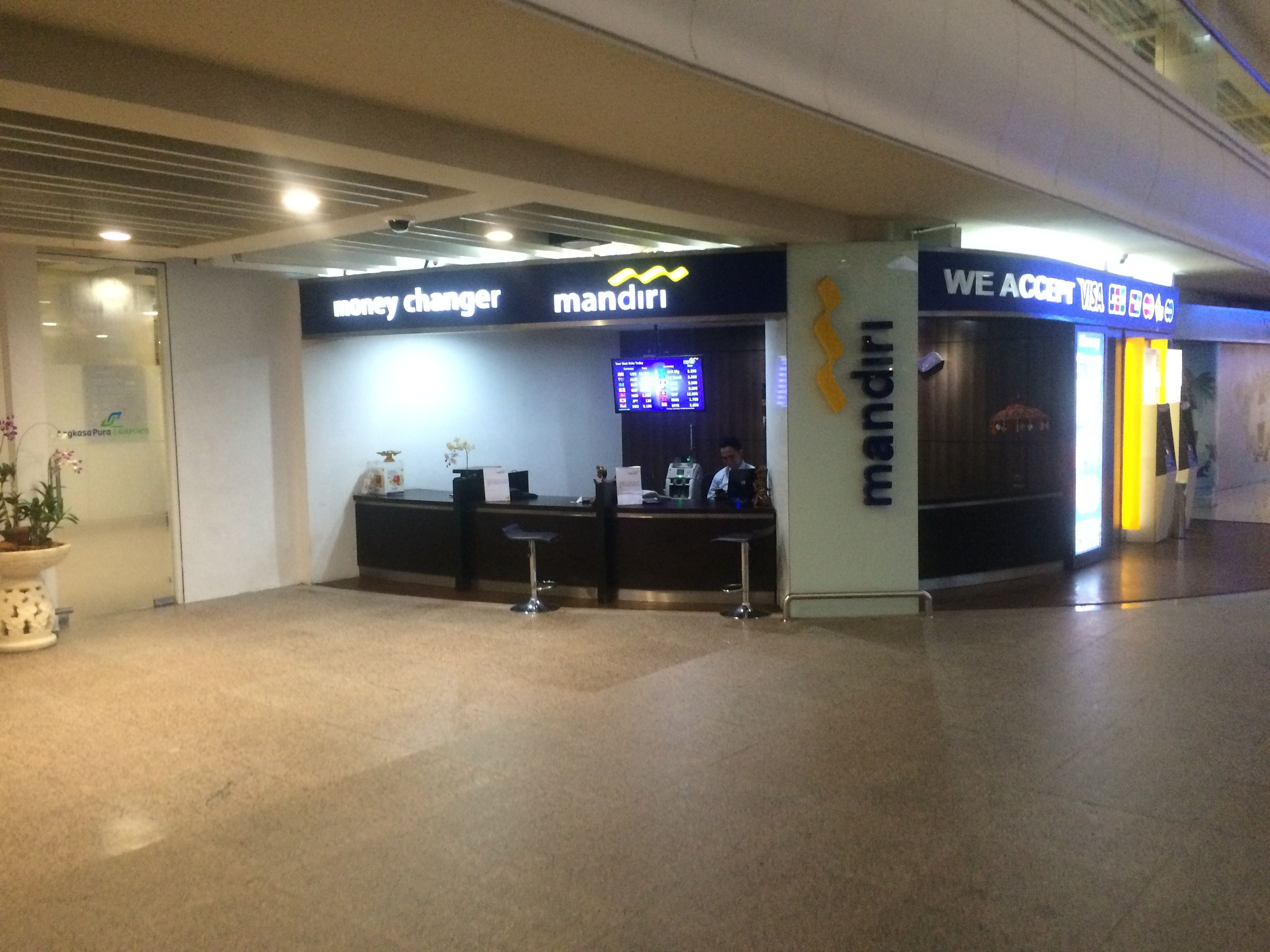 bank mandiri in arrivals hall. there are x3 money exchangers located in the arrivals hall along with ATM'S. The exchange rates in the airport are considerably lower than rates in kuta/legian/seminyak/sanur/jimbaran etc