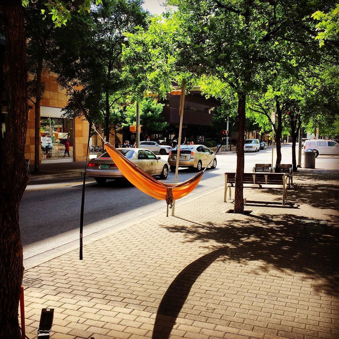 Hanging hammocks downtown Austin. Their should be hammocks spread through out the downtown area for people to relax and put their feet up. Let's make it happen if u see this hammock in the city please come and lay #joscoffee #dtaustin #hammocklife #icedturbo by @moncoco83