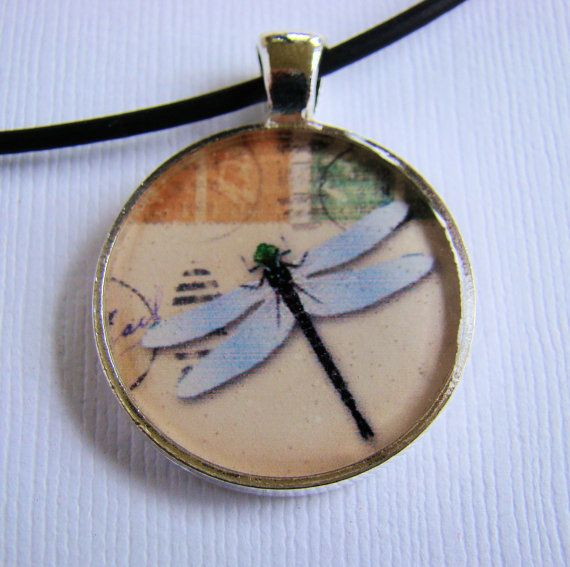Check out this item in my Etsy shop https://www.etsy.com/listing/163520297/resin-pendant-dragonfly-round-1-inch