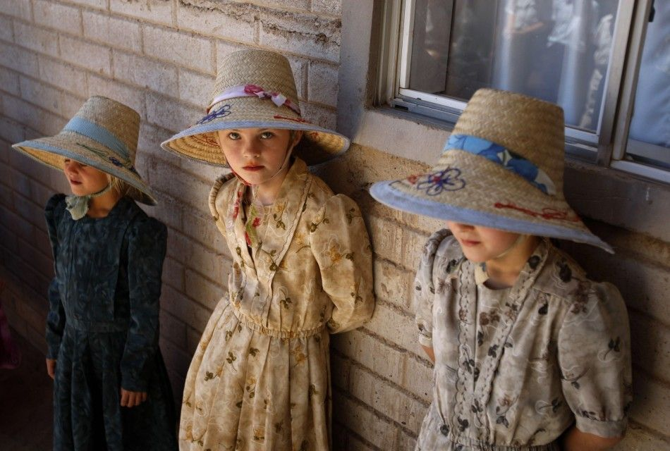 Mennonite girls wait outside their school in the Valley of Juarez.