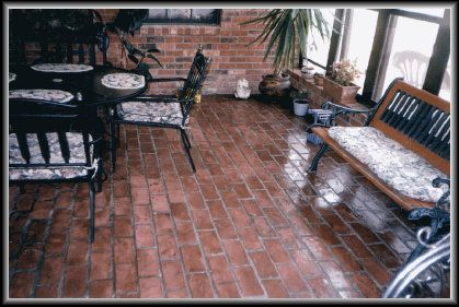 Brick linoleum | The previous floor of this enclosed