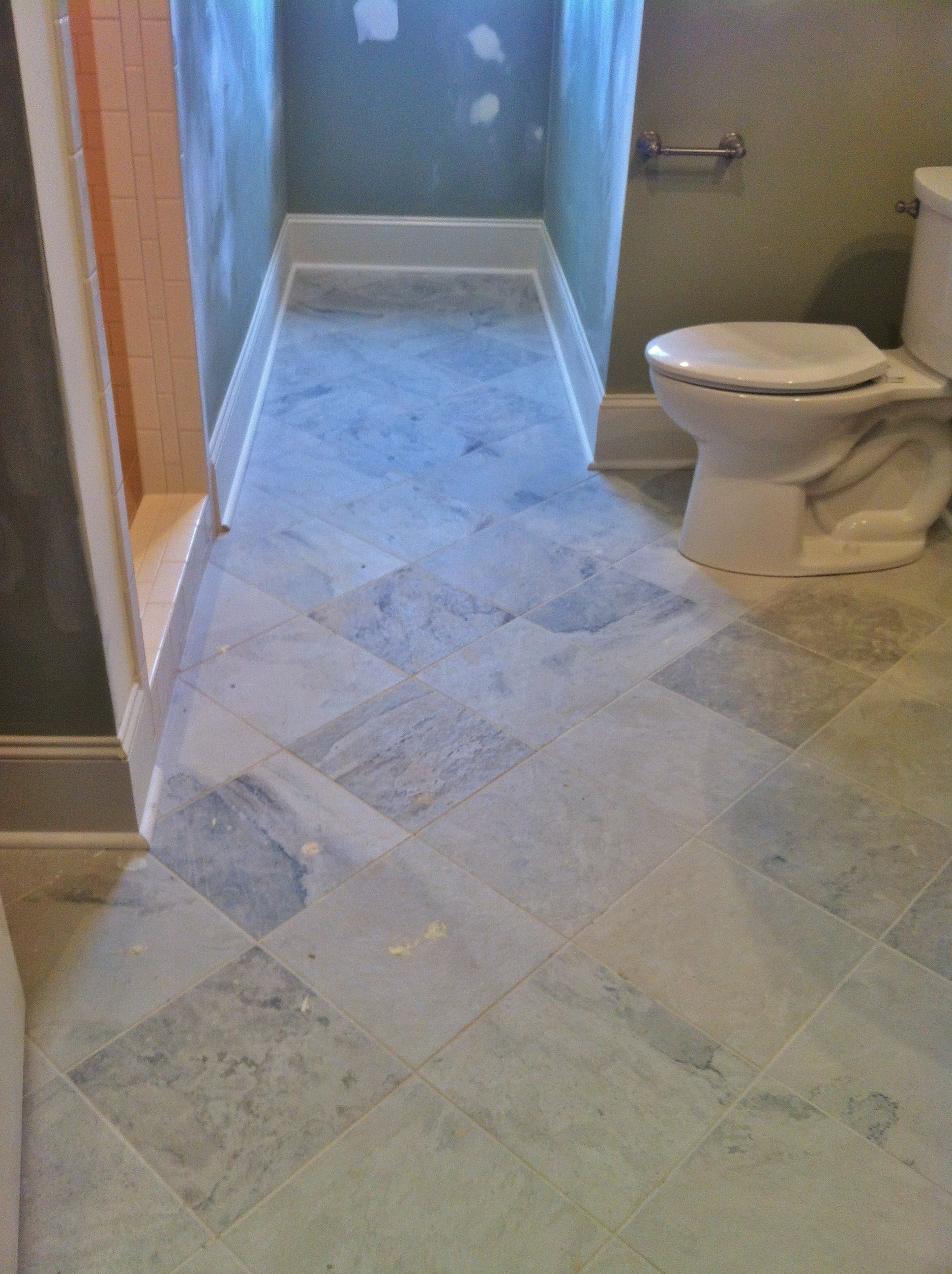 12x12 porcelain tile set diagonally on guest bathroom floor | Tile ...