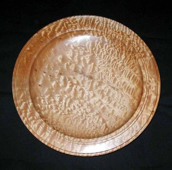 This platter is from an exceptionally nice piece of quilted maple. It's 22 inches in diameter, my largest to date.
