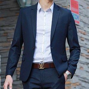 Navy suit, brown leather Louis Vuitton belt.